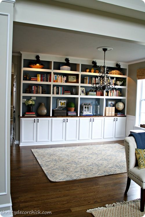 Added narrow bookcases to dining room. IKEA butcherblock counter tops,  inexpensive upper cabinets on