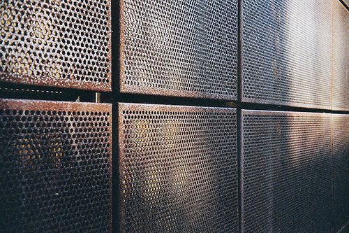 metal facade perforated cor ten steel via flickr metal. Black Bedroom Furniture Sets. Home Design Ideas