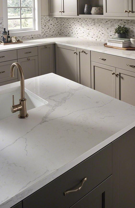 Moonshine cabinets and Carrara Marmi Quartz for the laundry room!