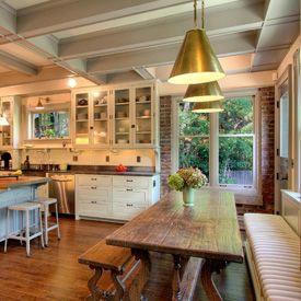 exposed brick, box beams, farmhouse table, industrial lights