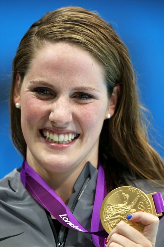 JULY 30: Missy Franklin of the United States celebrates with her gold medal during the medal ceremony for the Women's 100m Backstroke on Day 3 of the London 2012 Olympic Games at the Aquatics Centre on July 30, 2012 in London, England. You so deserved it, girl!