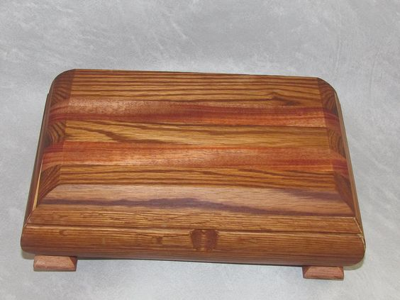 """Red Oak Handmade Keepsake Jewelry Gift Box with Mahogany Wood Accents. Handmade Red Oak Keepsake Jewelry Gift Box with Mahogany Wood Accents """"Radiance"""" The Radiance box takes its convex shape by literally curving the sides of the rectangle and laminating in the inside with solid cherry. The top features curved edges for a sophisticated contemporary look. I use hidden hinge pins for the top for smooth and effortless opening. Radiance is the perfect gift for that special person in your life…"""