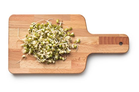 sprouted beans on cutting board