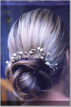 rach: this is quite sweet, w tiny little flowers in the hair.