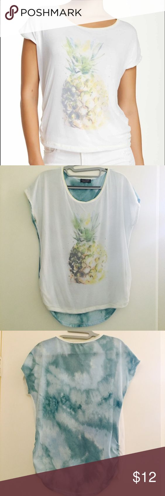 Vanilla Sugar Pineapple Mesh Tee Top Cute Short sleeve top. White front with pineapple design, mesh overlay. Back is a teal blue tie dyed color. Sides are sewn with a ruffle. Cute summer or vacation top. Worn a few times. From Nordstrom. Vanilla Sugar Tops Tees - Short Sleeve