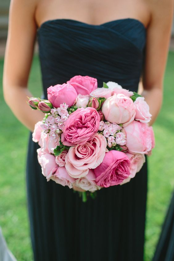 Dark blue bridesmaid dress and bright pink bouquet. Such a gorgeous color combo! Most people don't realize that blush and navy make for great neutrals