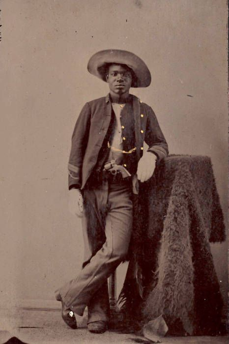 ca. 1860-80, [portrait of an unidentified buffalo soldier with buffalo hide and gun]  via Yale University, Beinecke Rare Book and Manuscript Library, Photographs of Afro-American Soldiers Collection