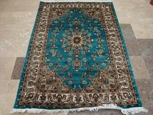 Hand-knotted silk rug