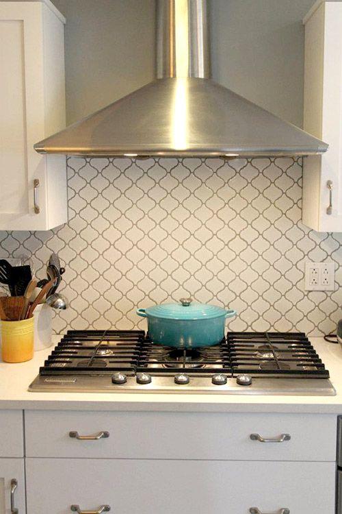 backsplash tile stainless appliances lanterns white tiles moroccan
