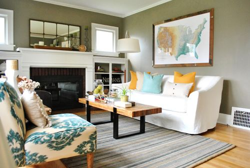 Craftsman style house - love the big map, the wall color & the mostly neutral color scheme with pops of color.