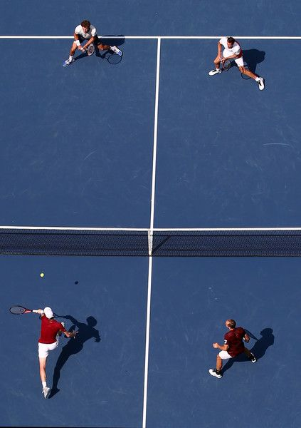 Jamie Murray (bottom L) of Great Britain and Bruno Soares (bottom R) of Brazil return a shot to Pablo Carreno Busta (top L) and Guillermo Garcia-Lopez (Top R) of Spain during their Men's Doubles Final Match on Day Thirteen of the 2016 US Open at the USTA Billie Jean King National Tennis Center on September 10, 2016 in the Flushing neighborhood of the Queens borough of New York City.