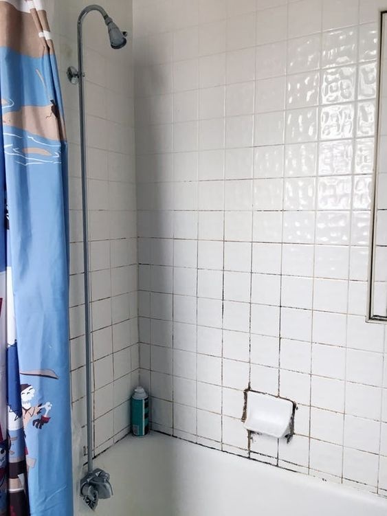 The Best Thing We Did To This Rental Bathroom Was Almost Free Cleaning Shower Tiles Shower Tile Cleaner Shower Tile