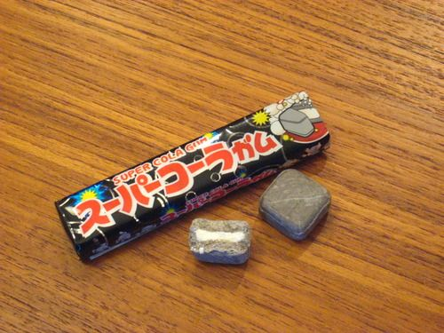 Super Cola Gum.  I bought this at a Japanese market.  This gum actually hurt to chew because it has huge sugar crystals.  The middle section of the gum is a powder that fizzes.  It's just weird but tasty... it is odd to blow grey bubbles.
