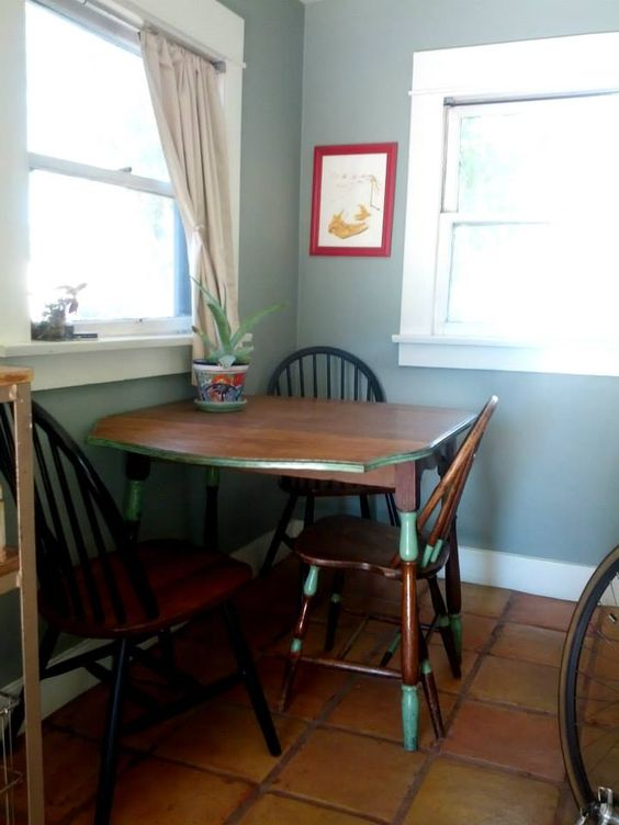 multi-purpose dining & crafting nook. In a small house, spaces have to be versatile and used for several purposes to get the utmost value from them. This is our cozy retreat to sip tea and have a quiet moment; play cards with friends; draw; and of course eat some snax!