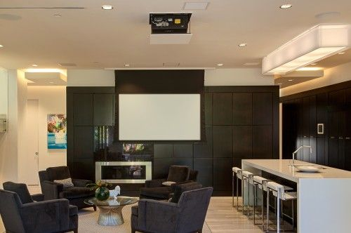 A large drop-down screen comes down from the ceiling when it's movie time. This screen is visible from the pool and patio area so it'll be outdoor movie night when the weather is right and the doors are open.