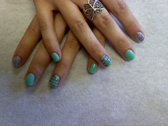teal with silver glitter and silver zebra accent nails  Oasis Salon and Spa mill Hall Pa (570)726-6565