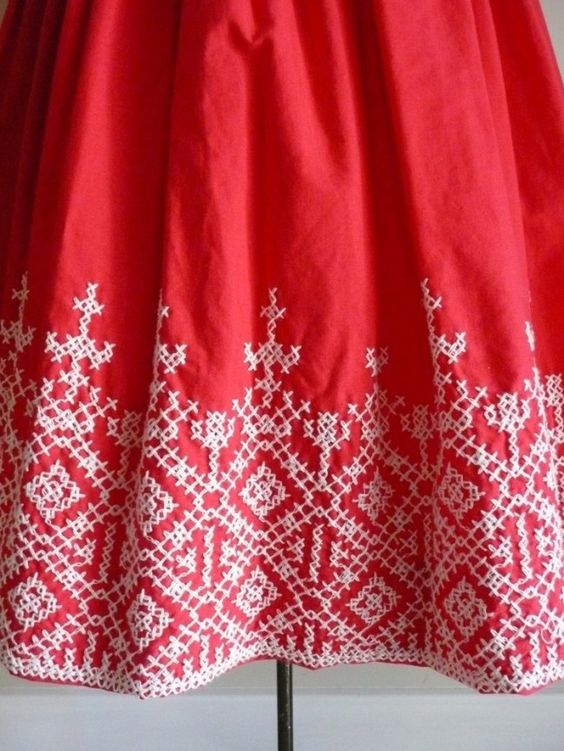 Beautiful cross-stitch detail on the hem of a dress- I'm thinking of turning this pattern into a fair-isle knitting pattern for a hat