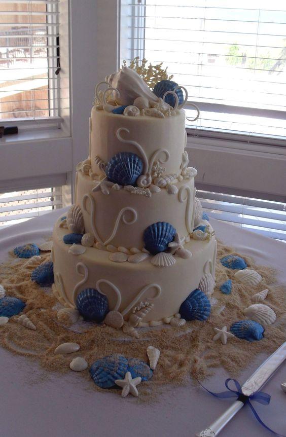 Beach-themed wedding cake: Beach Curl Blue by Just Desserts