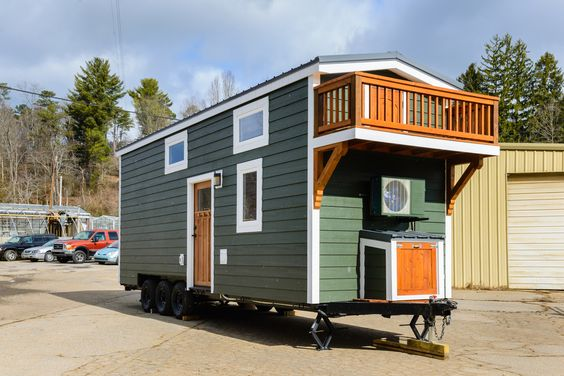 The Sheriff is a beautiful 208 sq ft tiny house by Wishbone Tiny Homes of Asheville, North Carolina. Features include a balcony and a walk-in closet!