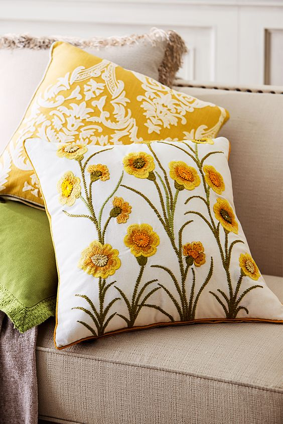 Embroidered sunny yellow blooms atop long narrow stems add a dose of spring to your sofa or chair. Pier 1's cheerful Spring Meadow Embellished Tulips Pillow features a hidden zipper for easy access to the poly insert.
