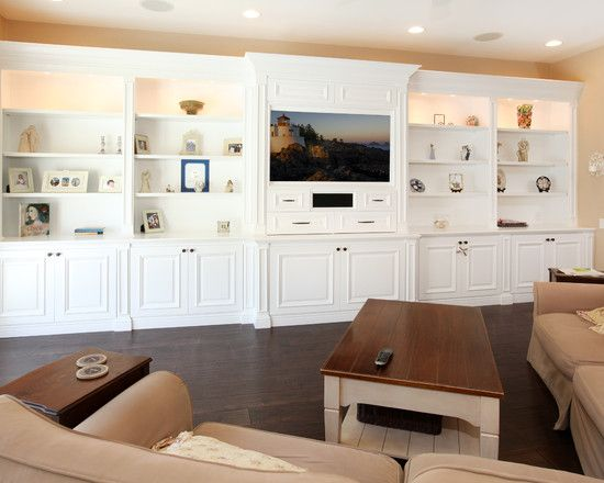 Tvs brown sofas and white built ins on pinterest for Elegant wall units