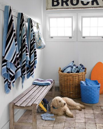 White bead board, big baskets, bench and pegboard... (Martha Stewart June 2009)