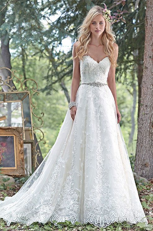 Dreamy lace and tulle combine to create this elegant ball gown wedding dress, with a romantic sweetheart neckline, and delicate Swarovski crystal belt accenting the waist. Maggie Sottero, Spring 2016