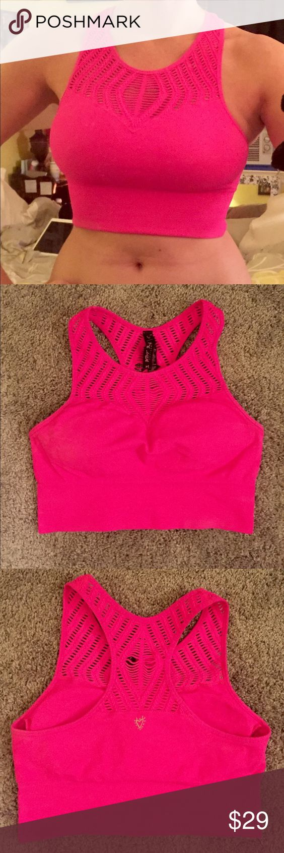 Betsey Johnson Performance Neon pink bra croptop Betsey Johnson Performance neon pink bra / bralette / sports bra / crop top / racerback with super cute and unique cut out pattern. Size medium with a lot of stretch and good support. Has removable pads. Worn around the house once or twice, in perfect condition. Retailed at $44. Betsey Johnson Intimates & Sleepwear Bras