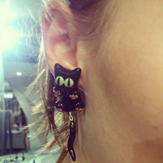 Black cat earrings! I made these for my grandma and she loves wearing them! Other people also seem to love them when they see them! Made in Polymer Clay!  Follow me on Instagram: http://instagram.com/justrandomclay