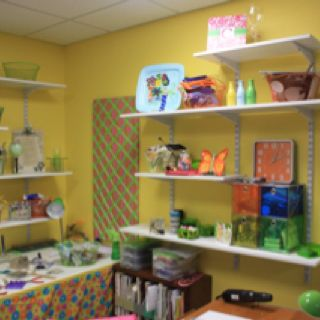 My craft room in the basement.  Bright colors make it a happy place to be.