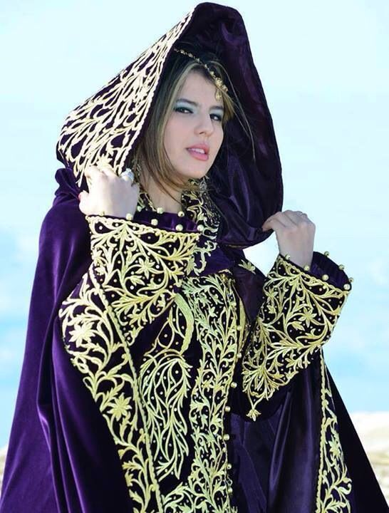 Algerian fashion: purple and gold bernoose
