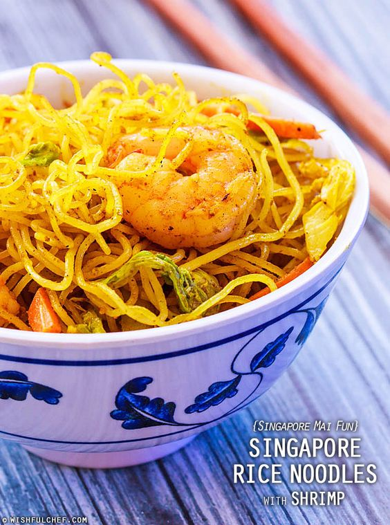 One of my favorite Chinese takeout dishes is Singapore Rice Noodles, a dish seasoned with curry, soy sauce and veggies. I love the aromatic flavors and the hint of spice. So if you're having a lazy day like me, try this recipe out. There's a bit of prep work involved, but once everything is prepared, the stir-frying should go smoothly.