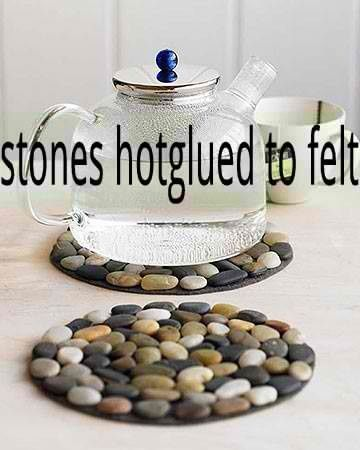 Stones hot glued to felt.  You could do so much with this.  Hot glue stones to heavier base for welcome mat, smaller stones to smaller base for coasters...love this.