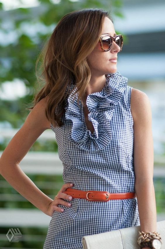 blue and white gingham dress and orange belt