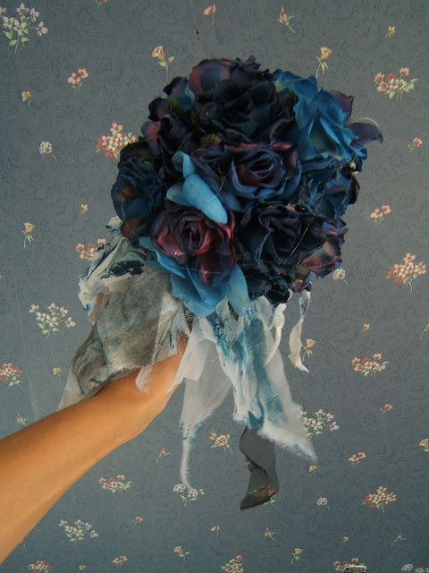 Here is the bouquet I made for Savannah's corpse bride costume....BEFORE I sprayed it with glitter!    Some people have asked me how I made these. For future inquiried. I found some old fabric flowers, painted them with midnight blue and black acrylic