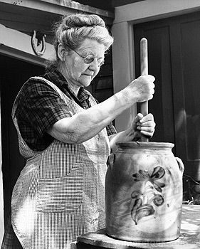 Aussiegirl...   churning butter! When I was little my Grandmother taught how to churn butter.....she lived in Milwaukee, WI....