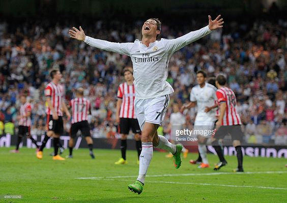 Cristiano Ronaldo of Real Madrid celebrates after scoring his team's 5th and his…