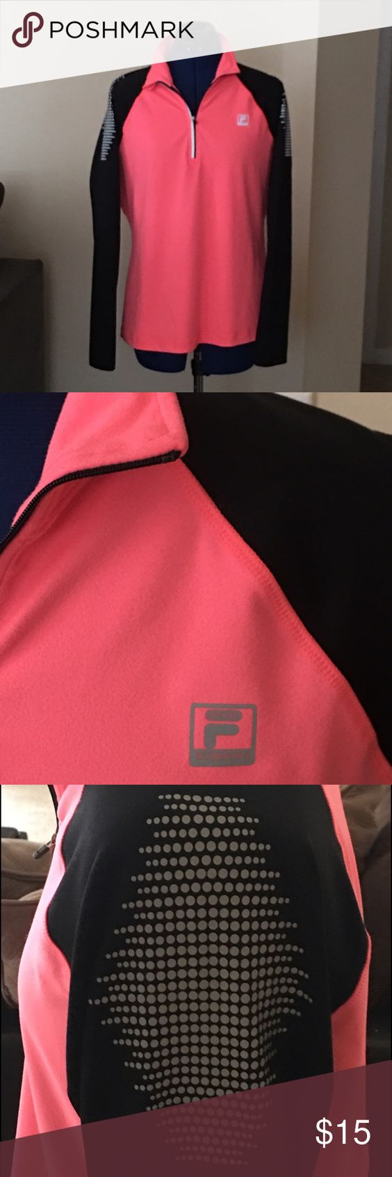 Sport top Soft and comfy Fila zip-up sport top! I love this great CORAL color and design! Just doesn't fit anymore! Fila Tops