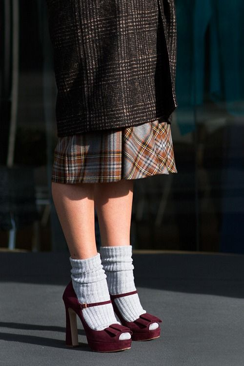 Love the mix of patterns and then the pop of color with the socks + sandals.