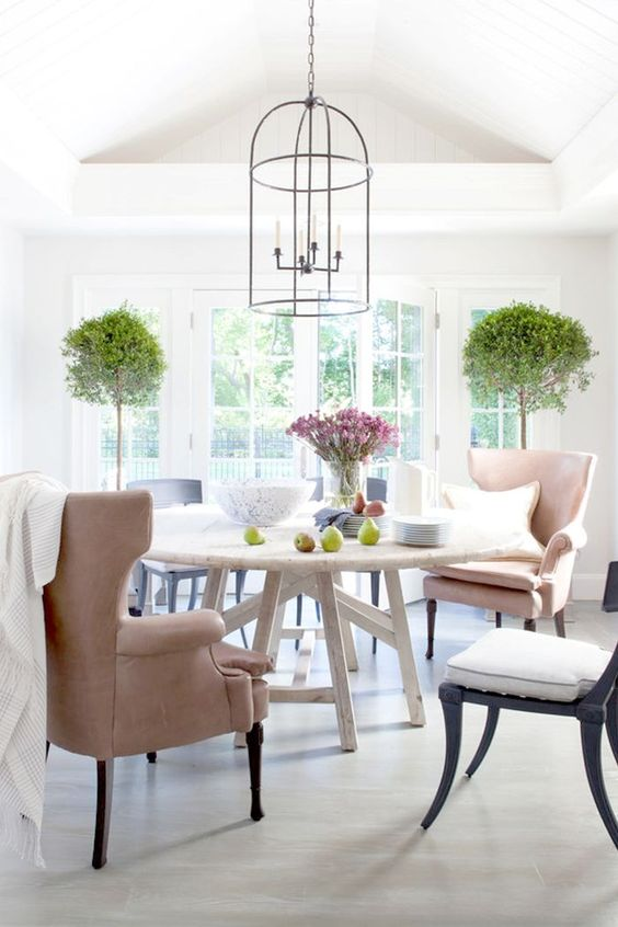 New Home Decor Ideas by popular Washington D.C. life and style blogger, Alicia Tenise: image of a dining room with a white round table, and wing back chairs.
