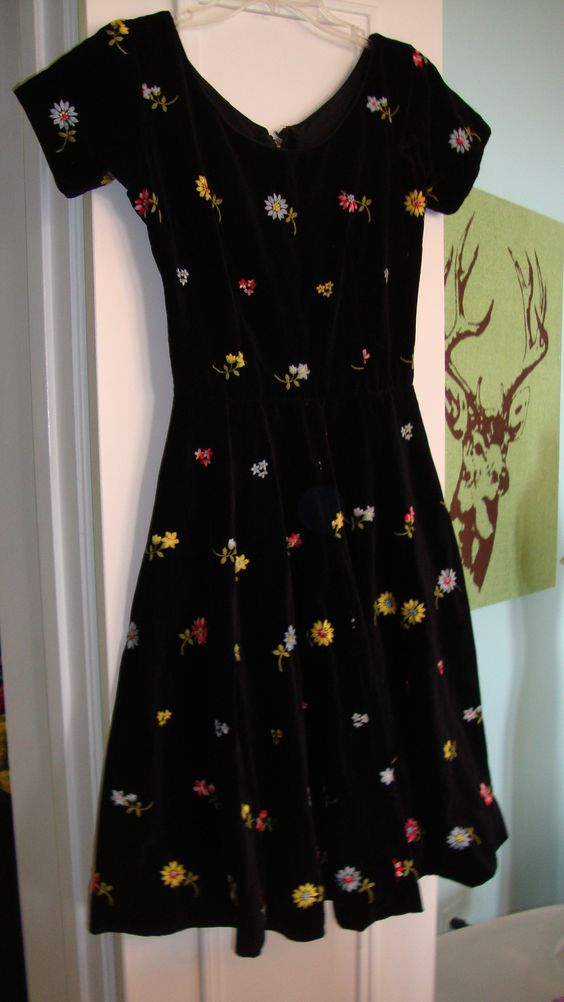 Gorgeous 1950's vintage velvet dress, with pockets. There is shattering to one arm, under the armpit. Swap or sell $50. I have more photos if people need them, of course.