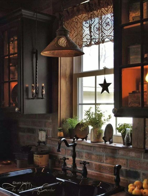 Lit up cabinets in this beautiful black & rustic kitchen <3