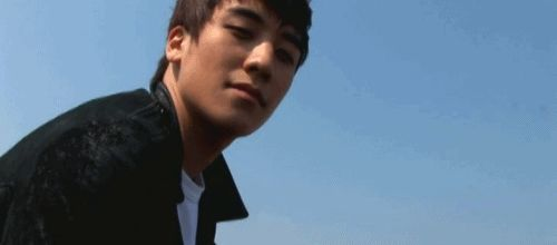 This is a gif of Seungri from the Kpop boy band Big Bang.