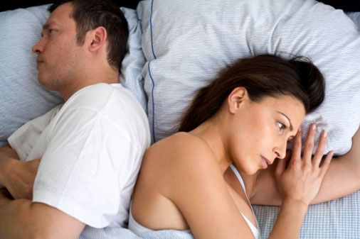 angry couples on bed