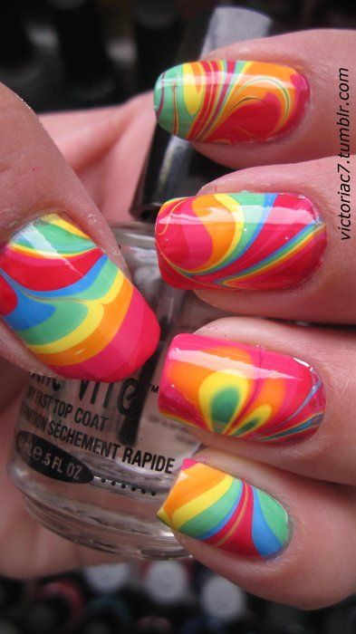 Tie Dye Water Marble nails...use small bowl with room temp water. Add drops of nail polish (dripping each on top of each other), carefully swirl. Dip. Looks like a pain, but cool.