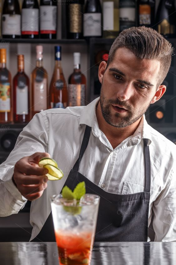 #Bartender  Barman decorating cocktail with lime: