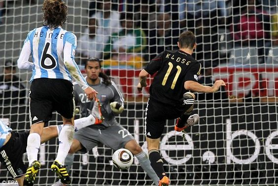 Net gains: Miroslav Klose strikes late on to seal the 4-0 victory...