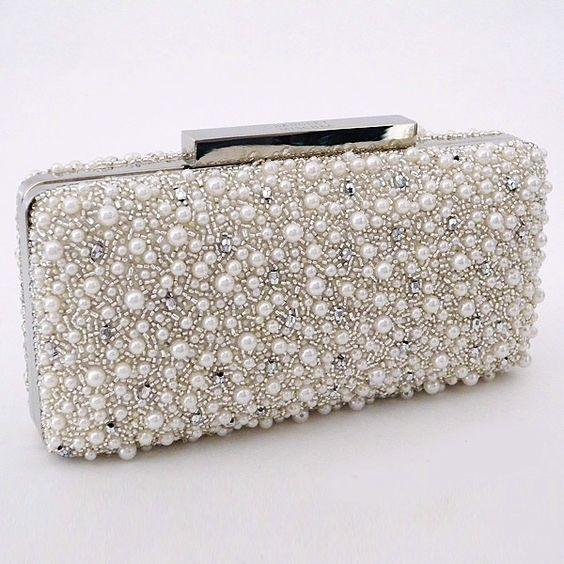 Badgley Mischka occasion handbags. Beaded pearl bridal clutch with rhinestone accents. The perfect accessory. Holds KLM & phone.  https://perfectdetails.com/210257.htm