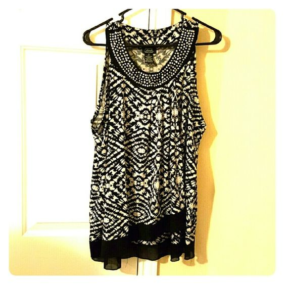Shannon Ford top Black and white used shirt. Fits tight with a flowy top layer. Super cute with a blazer and jeans. Shannon ford Tops Blouses