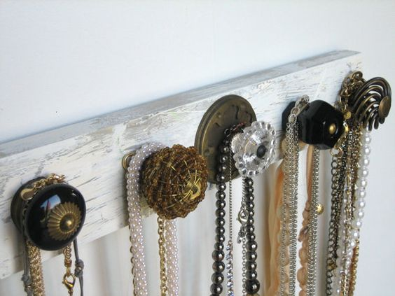 Beautiful, interesting knobs are a fun way to display scarves and necklaces.